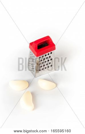 Small grater and a head of garlic on white background