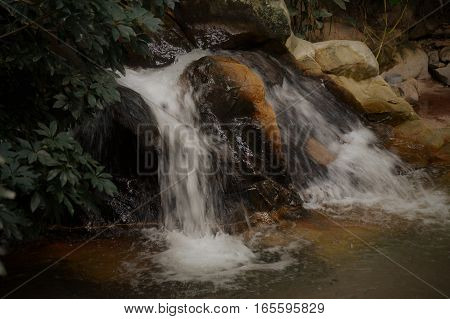 A waterfall in motion flowing over rocks
