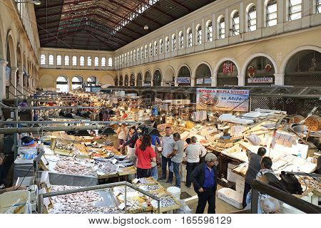 ATHENS GREECE - MAY 05: Fish Market in Athens on MAY 05 2015. Seafood Stalls with Fishmongers and Shoppers in Central Market in Athens Greece.