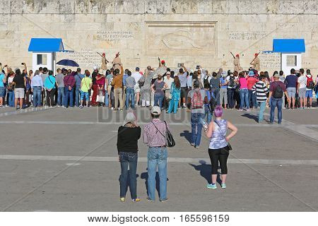 ATHENS GREECE - MAY 04: Changing Guard in Front of Parliament in Athens on MAY 04 2015. Bunch of Tourists in front of Hellenic Parliament Building During Ceremony in Athens Greece.