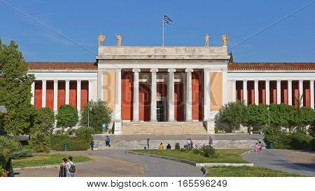 ATHENS GREECE - MAY 04: University of Athens on MAY 04 2015. Students in front of University Building View From Panepistimiou Street in Athens Greece.