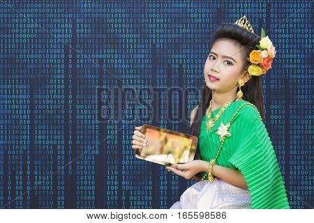 Thai Girl Children In Traditional Old Fashion Dress Green Tone With Computer Tablet.