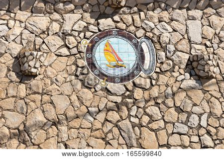 View of a beautiful decorative stone wall with ship