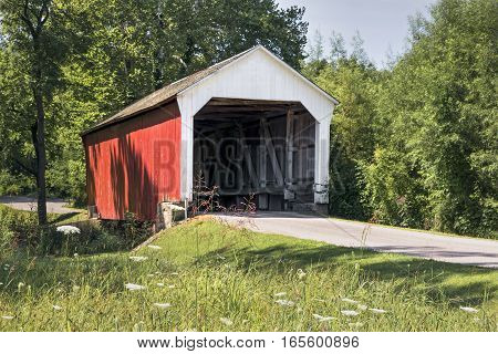 Phillips Covered Bridge built in 1909 crosses Rocky Run in rural Parke County Indiana near the town of Montezuma.