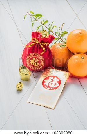 Chinese New Year,golden Envelope Packet (ang Pow) And Red Felt Fabric Bag With Gold Ingots And Orang