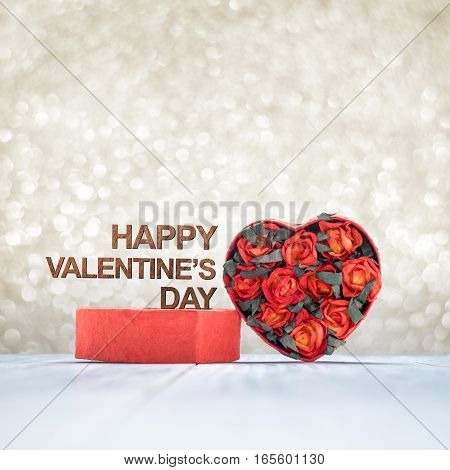 Happy Valentine's Day Word On Heart Shape Box With Red Roses Inside On White Wood Table Top At Blur