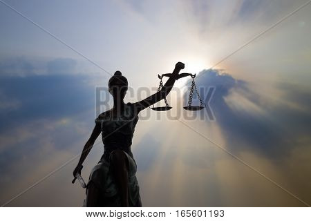 Shadow of Lady of Justice and light of God