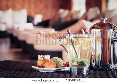 Camomile Tea With Dried Fruits. Woman At The Background. Spa Time Concept. Spa Lounge Area.