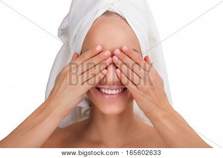 Beauty smiling Woman face Portrait in a towel close her eyes by hands.