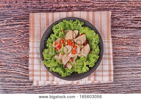 Spicy Mixed Vegetable Salad With Sliced Thai White Pork Sausage .