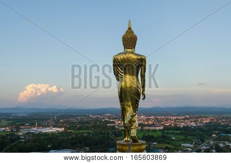 Big buddha at wat phra that khao noi temple and cityscape in nan province thailand