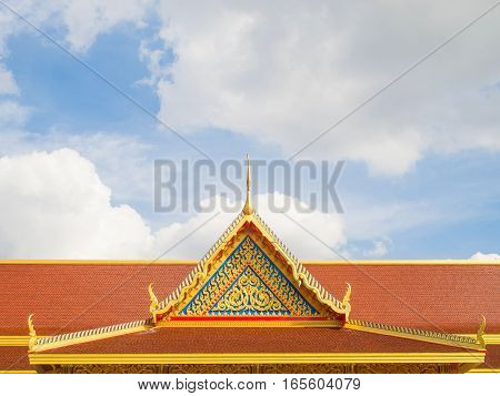 Thai buddhist temple roof and blue sky