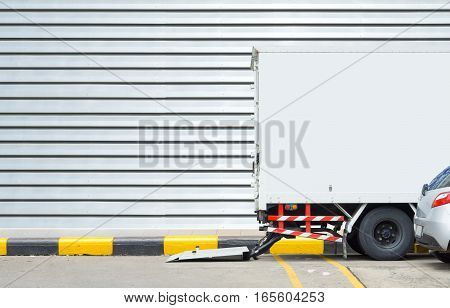Delivery truck and transportation car concept - Delivery truck parking for delivery post box to receiver on footpath and copyspace