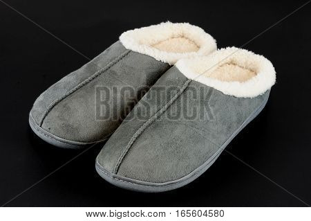 winter slippers isolated on black background for design