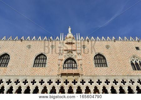 Beautiful gothic Doge Palace southern facade in Venice with blue sky