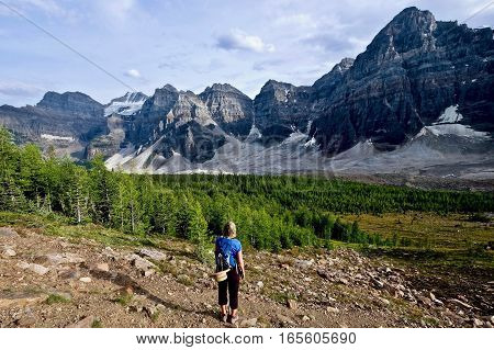 Woman hiking in mountain. Valley of Ten Peaks. Banff National Park. Canadian Rocky Mountains. British Columbia. Canada.