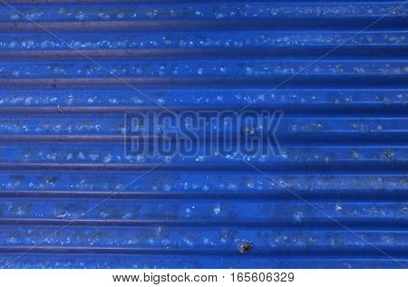 Blue corrugated metal with bolts , background