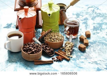 Still life of coffee - green and brown beans and spices, cinnamon and anise