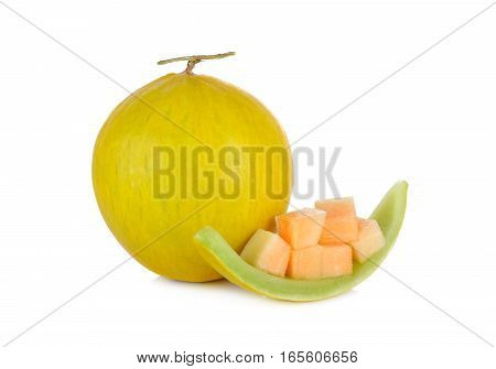 whole and portion cut fresh yellow melon with stem on white background
