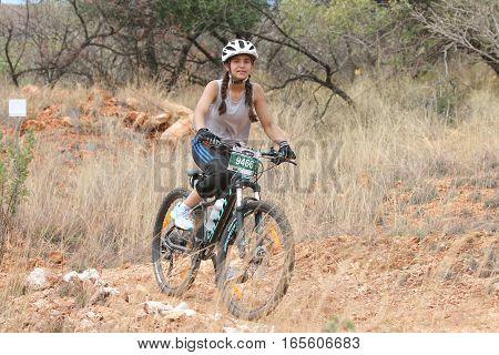 Young Inian Girl Riding Through Bush At Mathaithai Mountain Bike Race