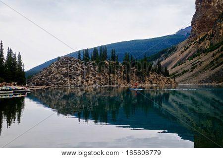 Peaceful paddleboarding in alpine lake. Moraine Lake.  Banff National Park. British Columbia.   Canada.