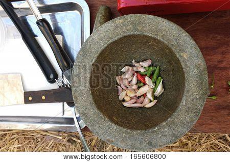 Thai ingredient  garlic and chile paprika in mortar