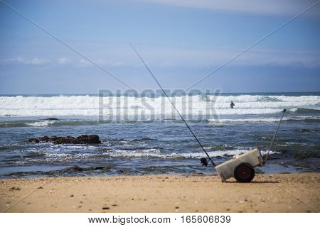 Fisherman waded out into the waves to catch his fish