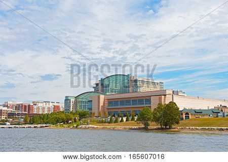 OXON HILL MARYLAND USA - SEPTEMBER 11: National Harbor waterfront buildings on September 11 2016. The resort restaurants and shops attract tourists and locals.