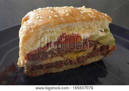 Delicious burgers with beef, tomato and  cheese , Section view burgers , Thai cuisine