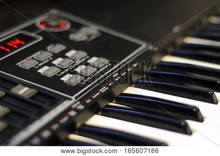 Electric piano with faders, button and knobs