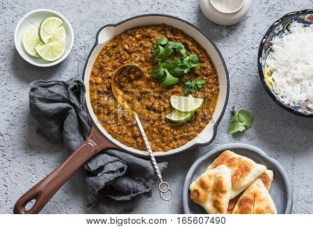 Cream coconut lentil curry rice naan bread - vegetarian lunch buffet. Top view flat lay