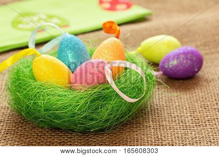 Easter still life with colored eggs and napkin. Easter in a country style