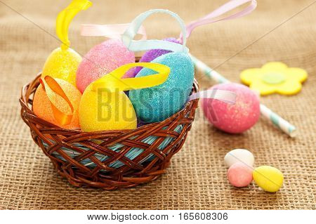Easter eggs in the decorative nest. Easter still life in a country style with colored eggs.