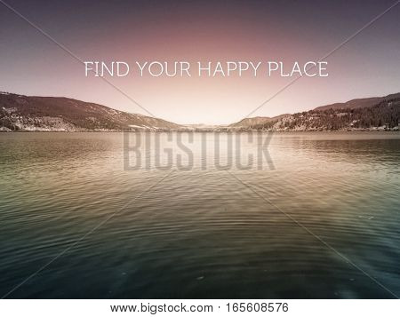 Inspirational quote on scenic lake landscape with reflections on water. Mountains and clear sky with lighting effects.