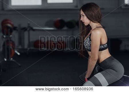 Young Beautiful Woman Sit On Fitness Ball In Gym.