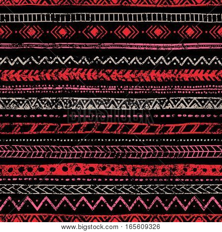 Seamless vintage pattern. Ethnic and tribal motifs. Grungy texture. Black, pink, gray and purple colors. Vector illustration.