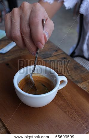 Morning coffee , Cup of espresso coffee on wooden table