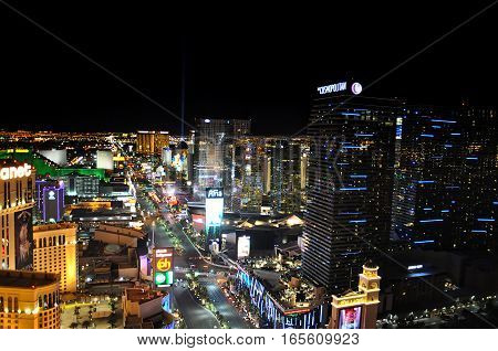 VEGAS NEVADA USA - January 11th 2016: Vegas strip at night with Bellagio Aria Cosmopolitan Luxor sky beam and other hotels