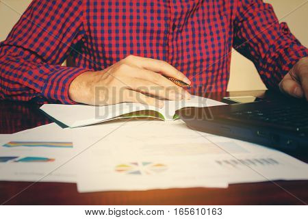 Businessman Using Laptop Searching Analysing Data At Home Office.