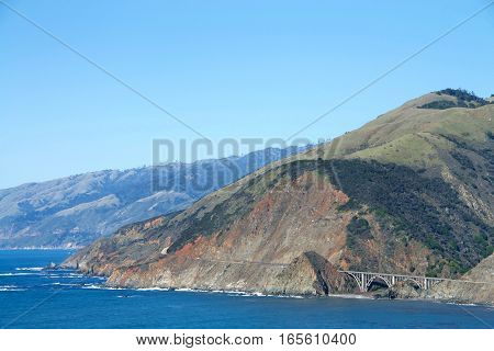 View of Pacific Coast Highway south of Big Sur with the Bixby Bridge the most photographed bridge on the Pacific Coast.