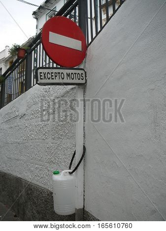 Water Container Chained To Post