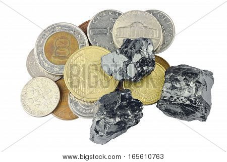 Raw coal nuggets on different coins on top isolated on white background