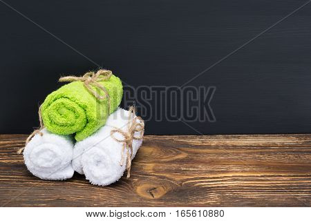 Three towels on a dark background in the salon spa