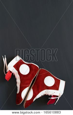 Shoes protect the feet in sports of Greco-Roman wrestling against a dark background