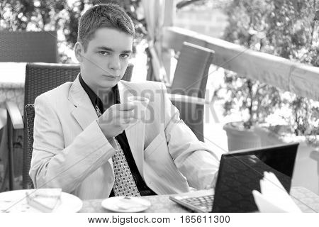 Portrait Of Young Man In The Business Suit, Businessman, Laptop, Coffee, Black And White