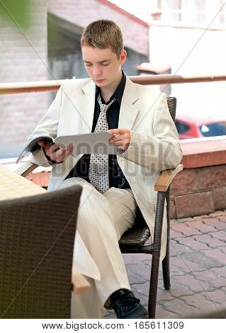 Portrait Of Young Man In The Business Suit, Businessman, Reading A Magazine
