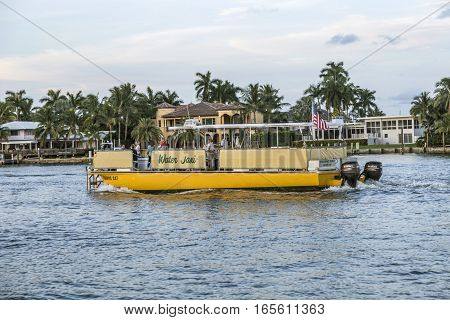 FORT LAUDERDALE USA - AUGUST 20 2014 : people travel in Water taxi in Fort Lauderdale USA. Water taxi is popular by local people as well as by tourists.