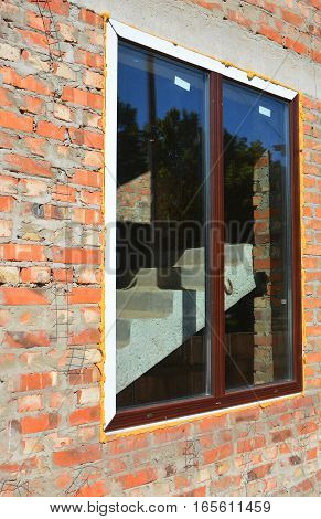 Window installation and Replacement Details with Concrete Lintel. Window Construction with Insulation.