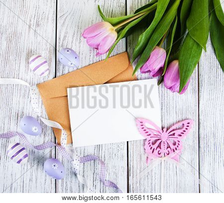 tulip bouquet and blank greeting easter card with eggs