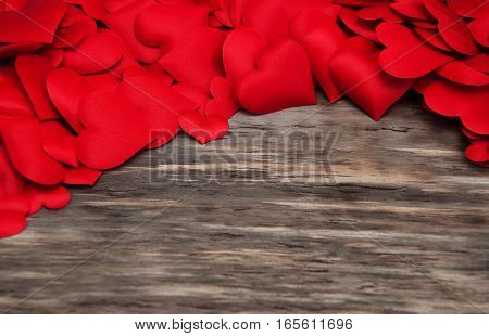 Red Hearts On A Wooden Background